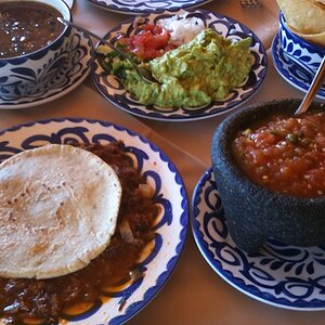 """Botana (appetizer), consisting of (clockwise from bottom-left):  -- """"Atropellado"""" (""""roadkill"""").  A handmade tortilla is the only decent wrap. -- Sa"""