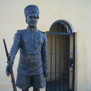 Model of the then policeman guarding the prison tower gate.